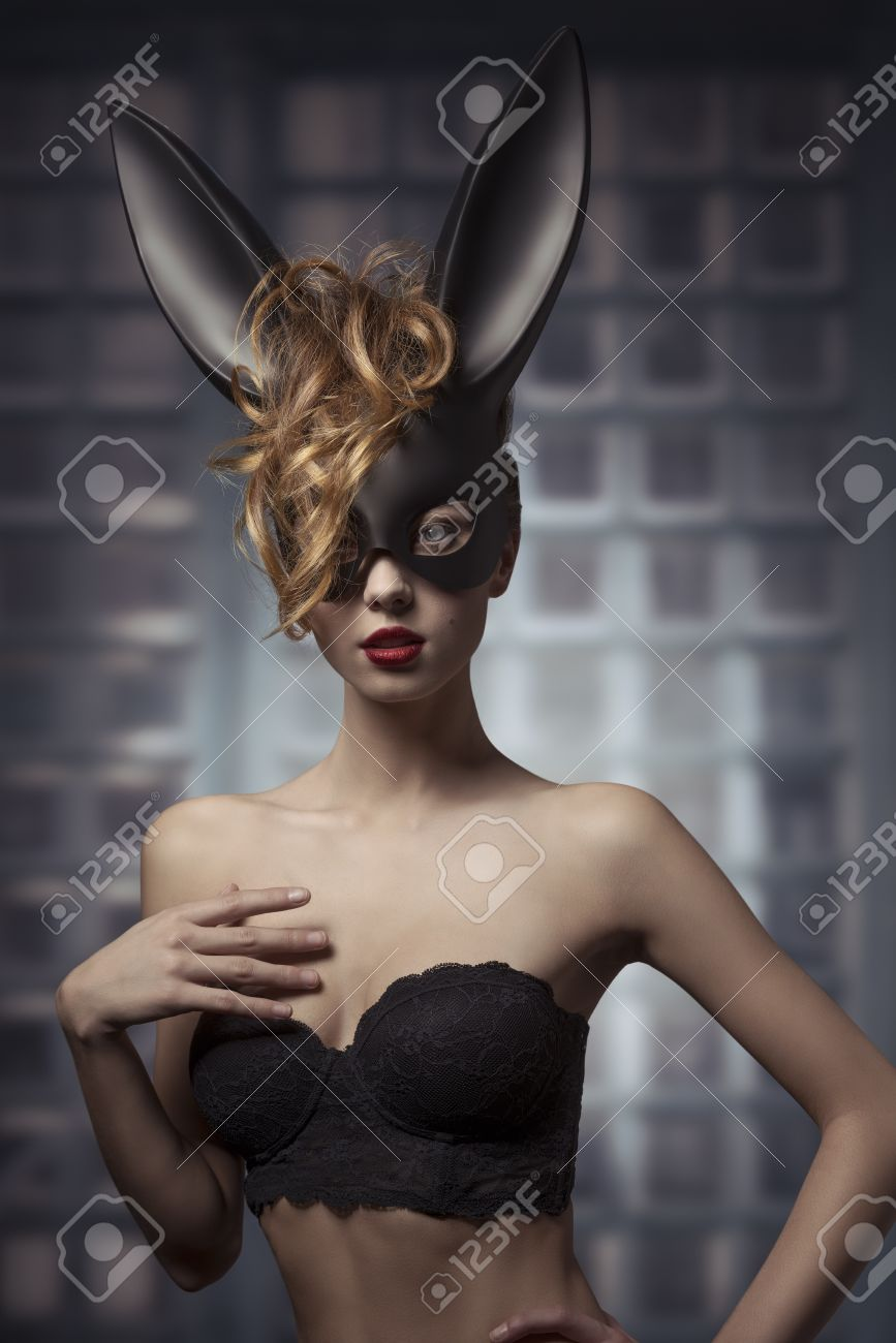 Stock photo fashion easter creative portrait of mysterious woman with blonde curly hair style and lack bra
