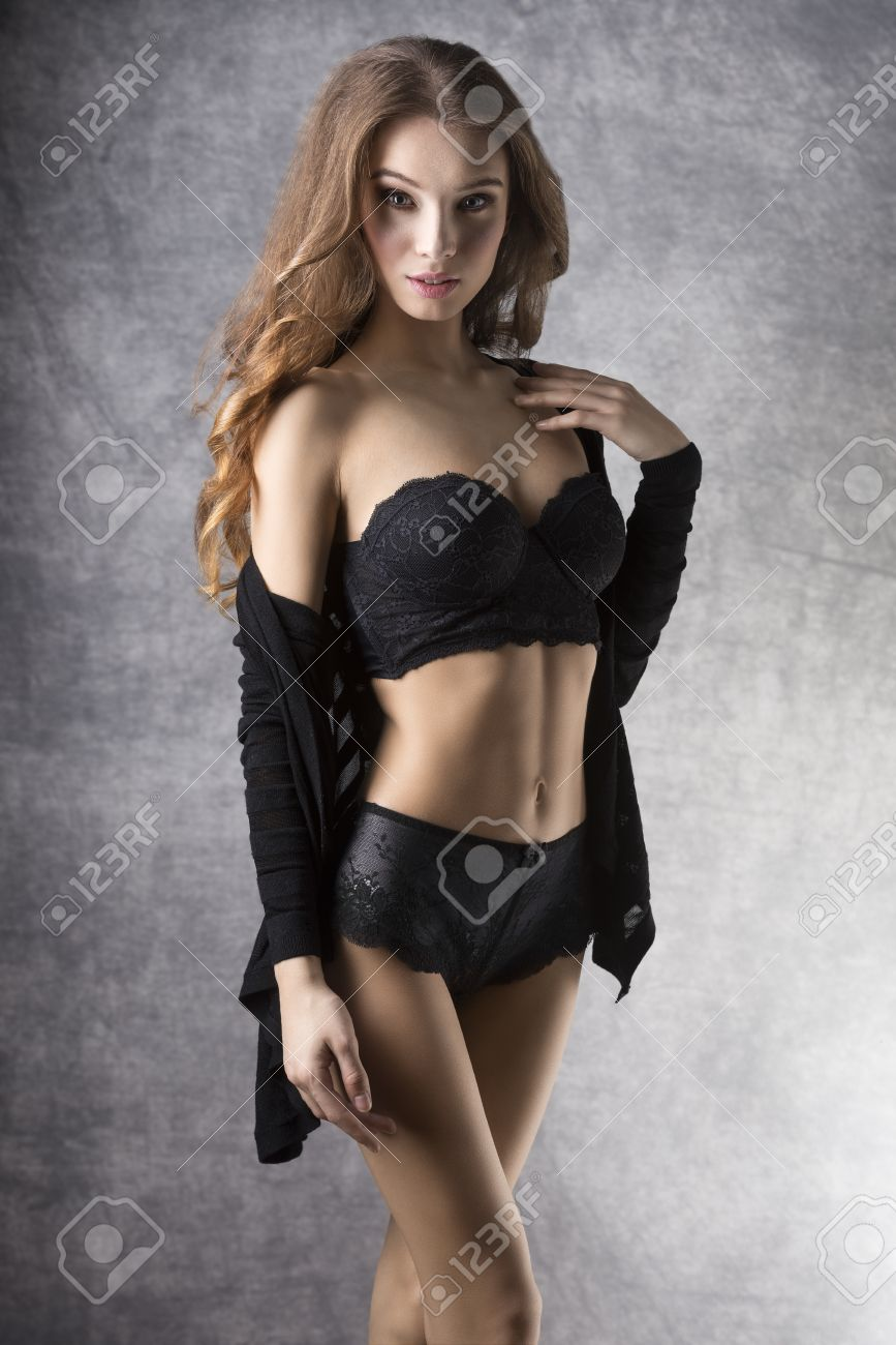Gorgeous sexy blondes in lingerie Pretty Sexy Gorgeous Natural Women With Long Blonde Curly Hair In Black Lingerie And Jumper She Has Got Make Up Stock Photo Picture And Royalty Free Image Image 38680824