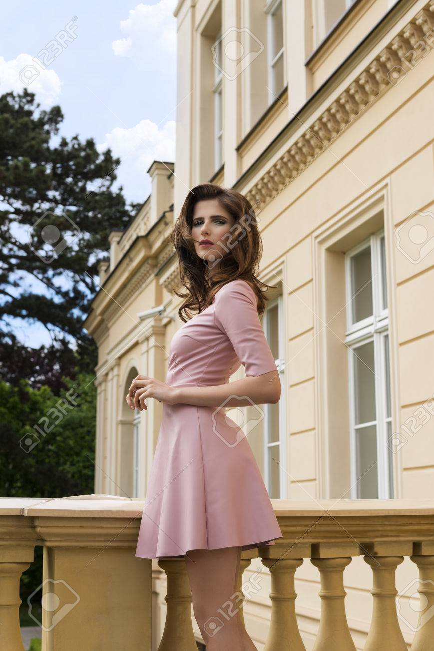 9da750a206 cute brunette woman with fashion pink dress posing in summer outdoor  portrait with natural hair-