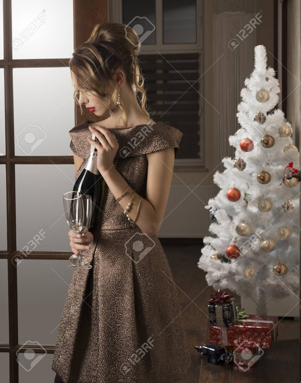 87eec77bc2ee sensual brunette girl with elegant style at happy new year party taking  bottle of champagne and