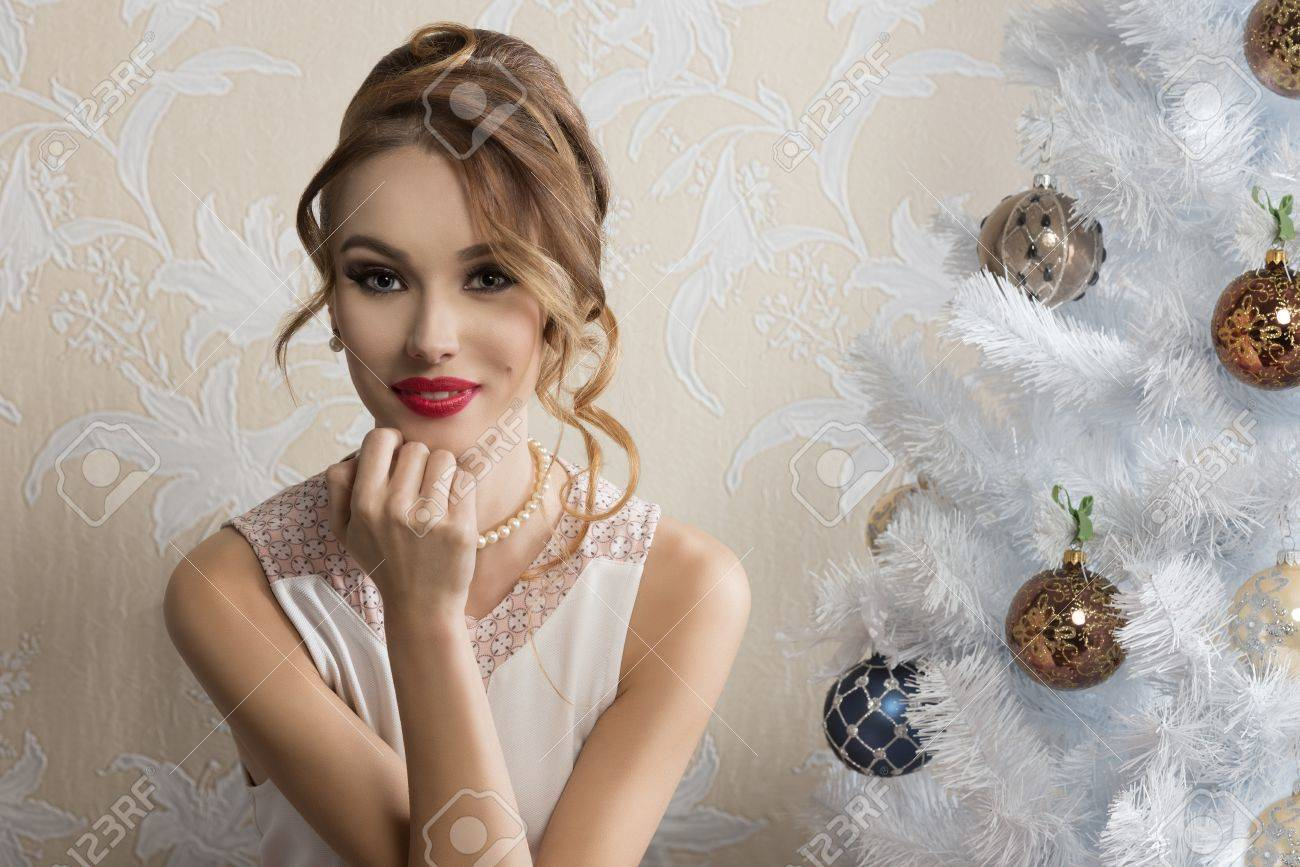 Lovely Elegant Woman Posing In Romantic Christmas Portrait With