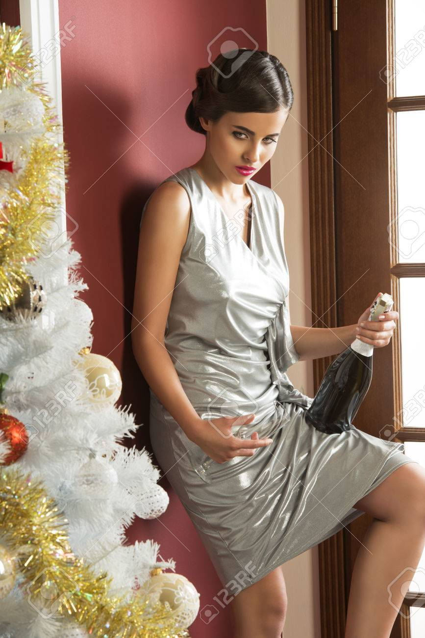 b4d3247ddc4c Happy new year party. xmas portrait of elegant brunette woman with silver  dress, hair-style and make-