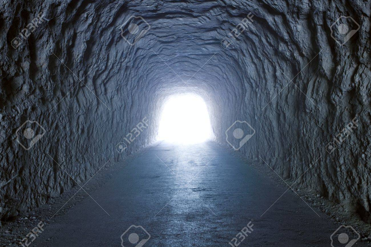 Inside a tunnel inside a mountain with light at the end Stock Photo - 8141939