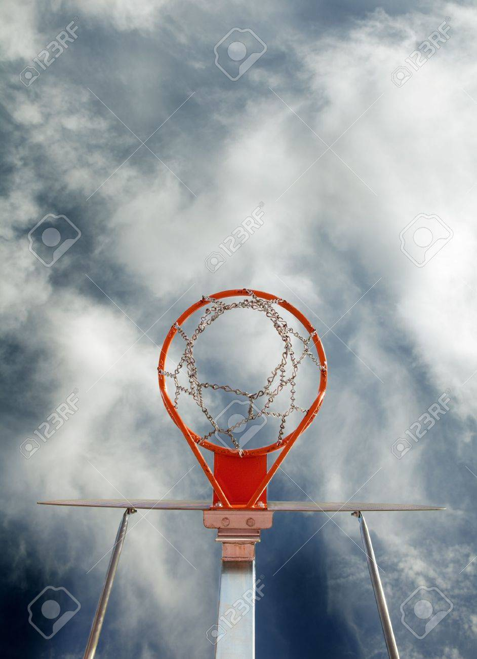 abstract image of basketball goal against the sky stock photo