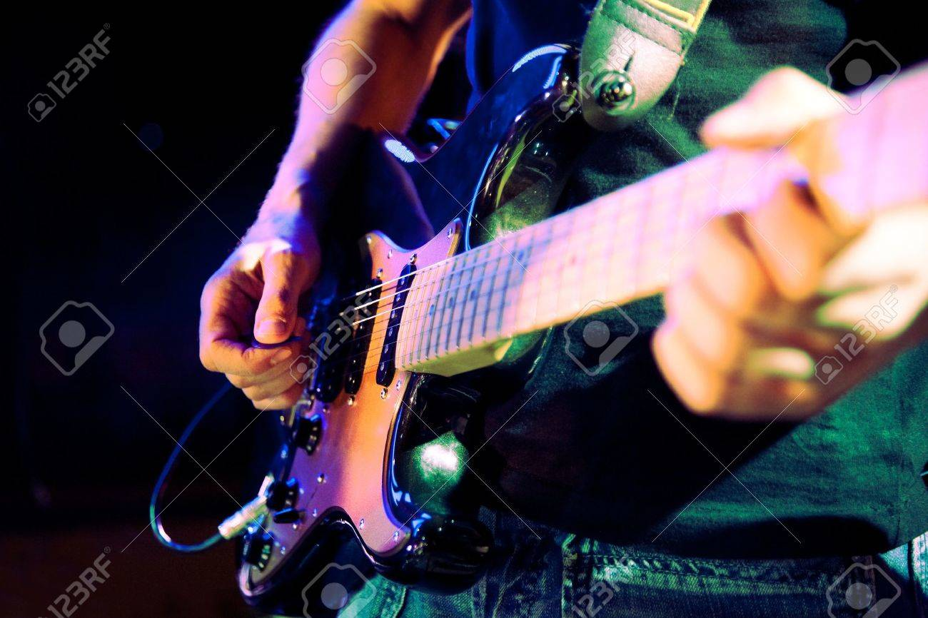 Close up image of guitar player on stage - 18586238