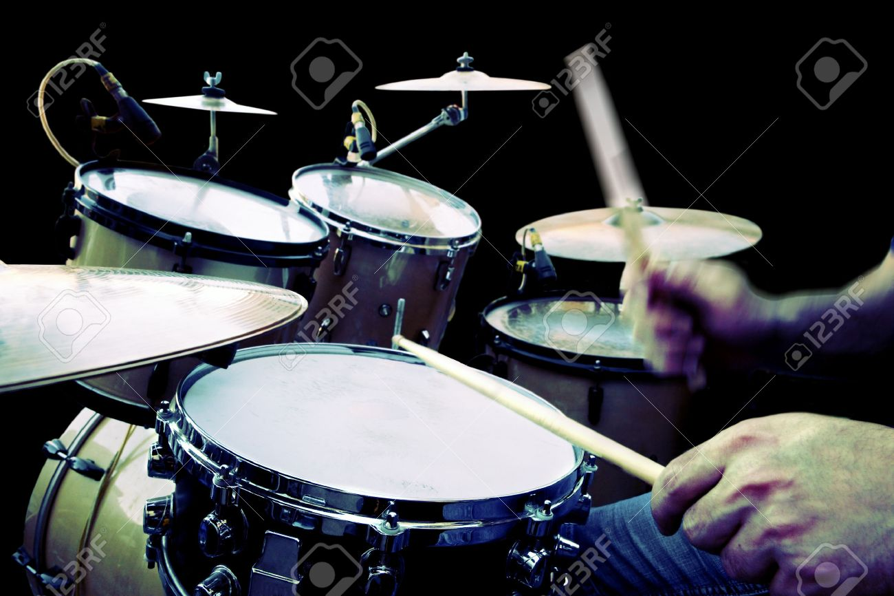 drummer playing isolated over black - 26870467