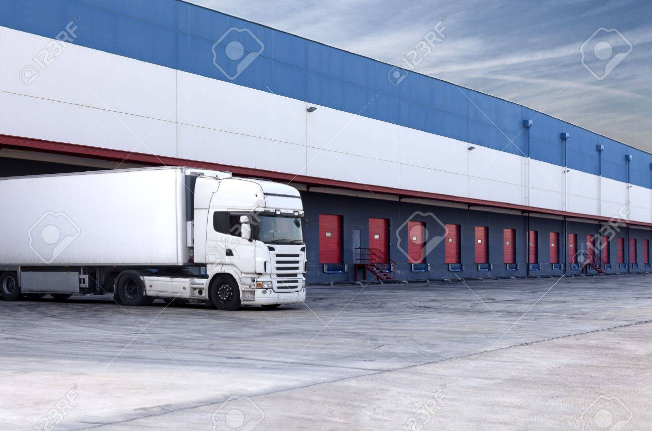 truck loading at a warehouse building. - 26870507