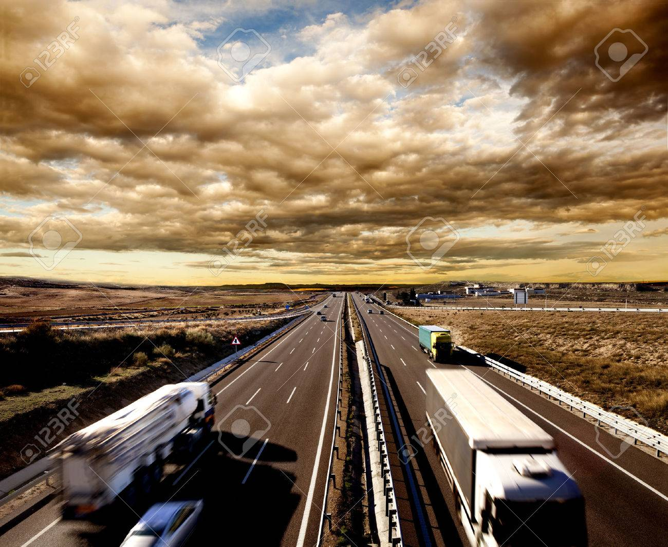 International shipment, trucks and cars driving on the highway. Logistics and warehousing - 50030414