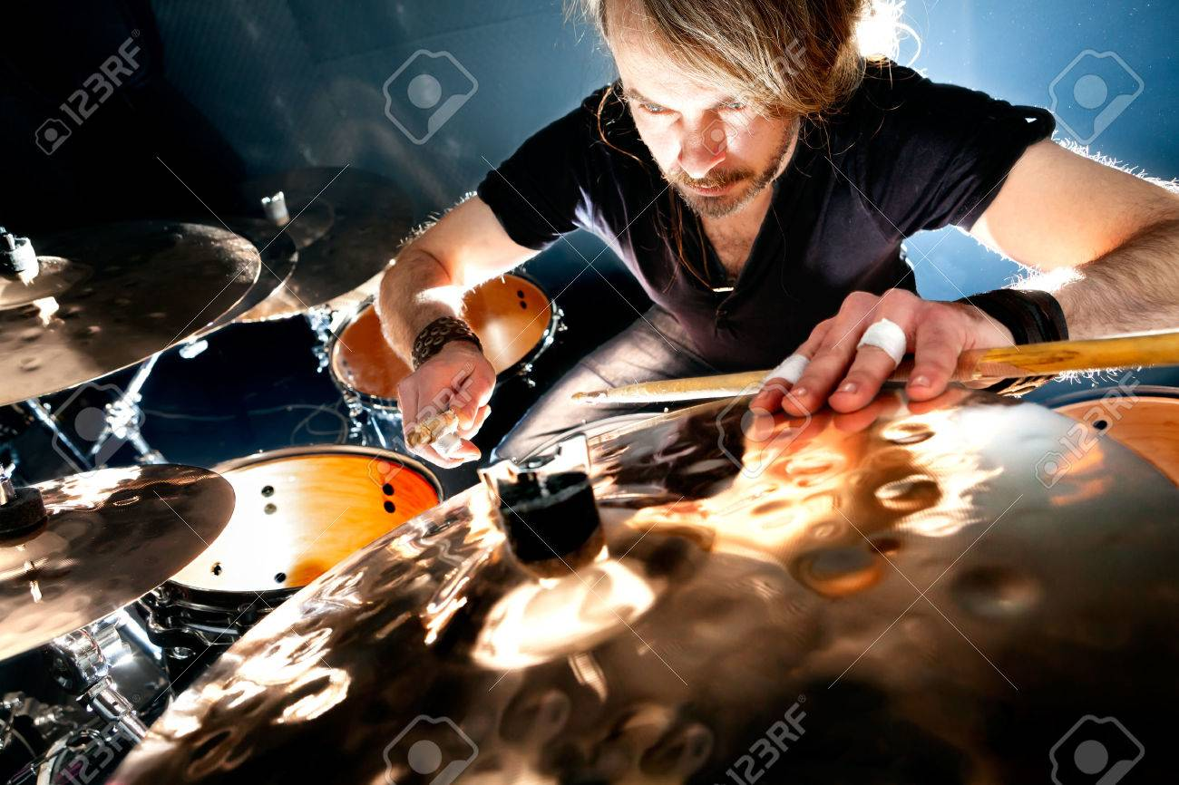 Man playing the drum.Live music background concept.Drummer and rock music - 50030360