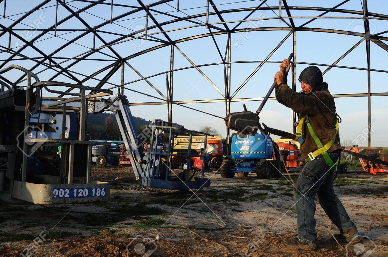 ALCALA DE HENARES , Spain - 04 April 2011-Straining wire .Construction of the Museum