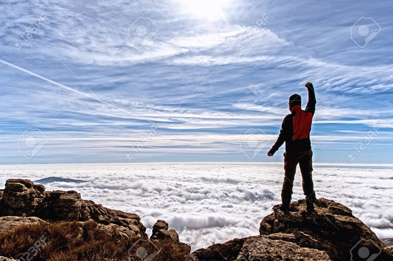 Man in the high of the mountain filled with enthusiasm with the impressive panorama that he contemplates Stock Photo - 18009179