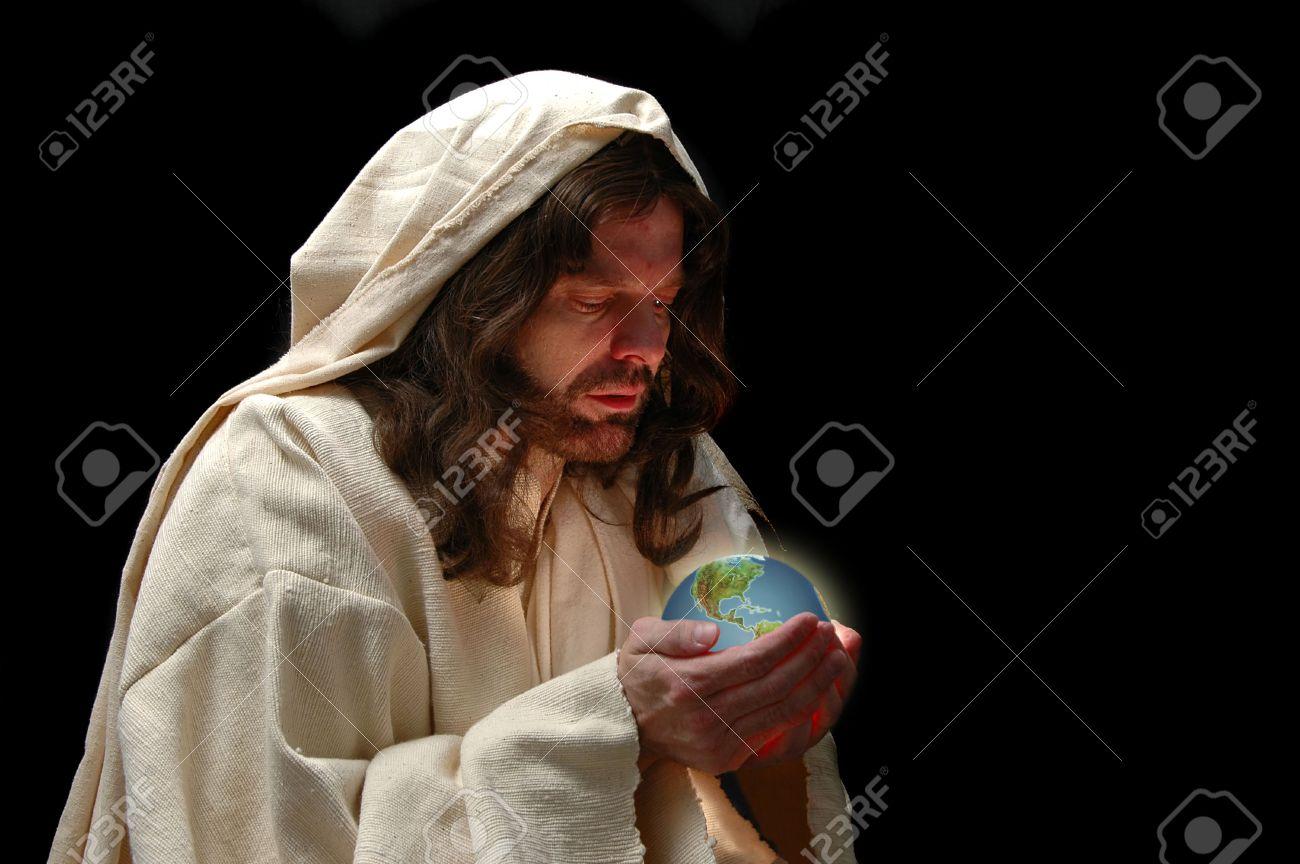 Portrait of Jesus holding the world with dark background Stock Photo - 1125001
