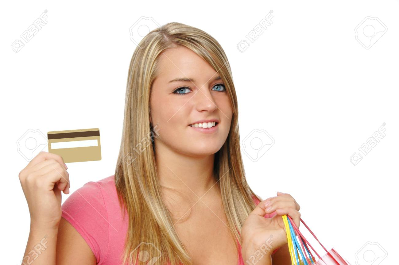 Beautiful teen girl with blank credit card and shopping bags Stock Photo - 7772381
