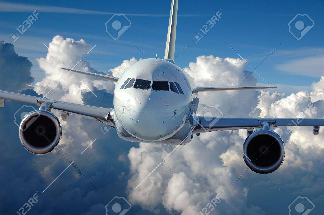 Commercial airliner in flight over a cloud covered background. Stock Photo - 7796578
