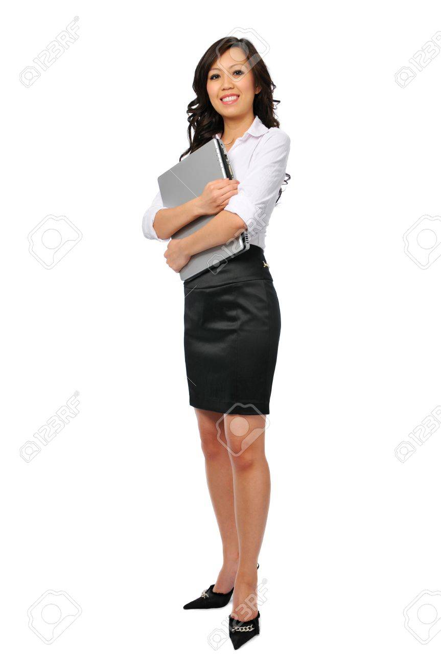 Young businesswoman with laptop isolated on white and standing Stock Photo - 7797027