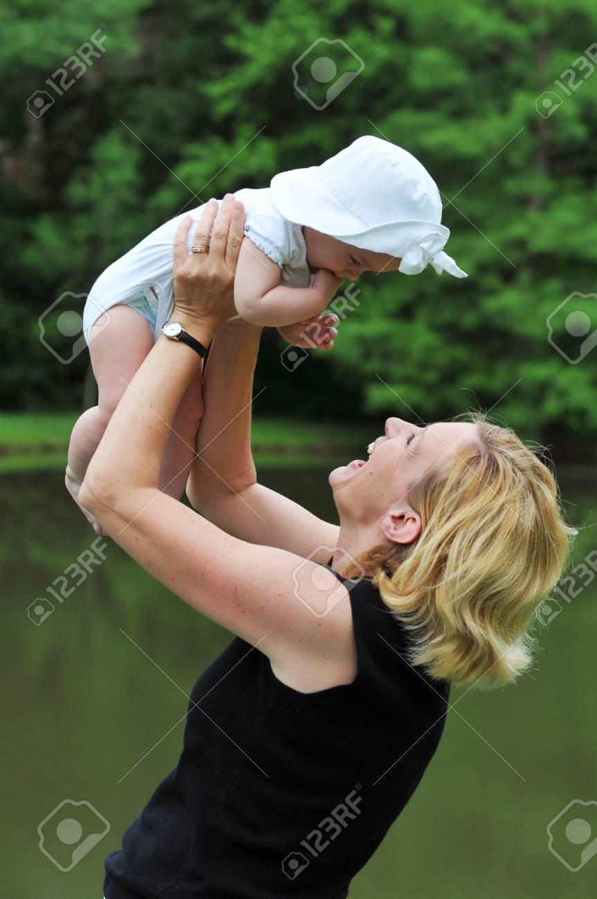 Mother holding her daughter outdorrs Stock Photo - 7796838