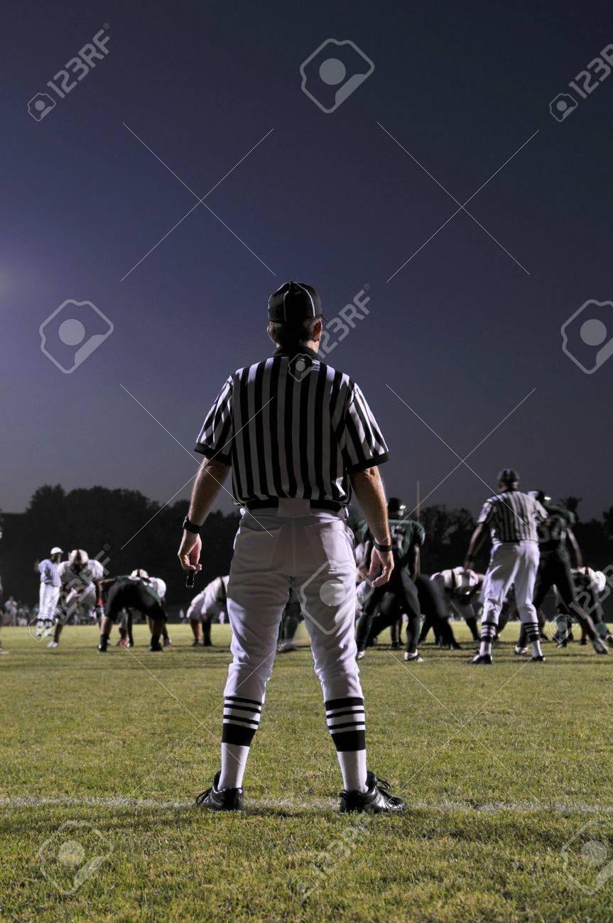 Referee at a Football game at night - 7900520