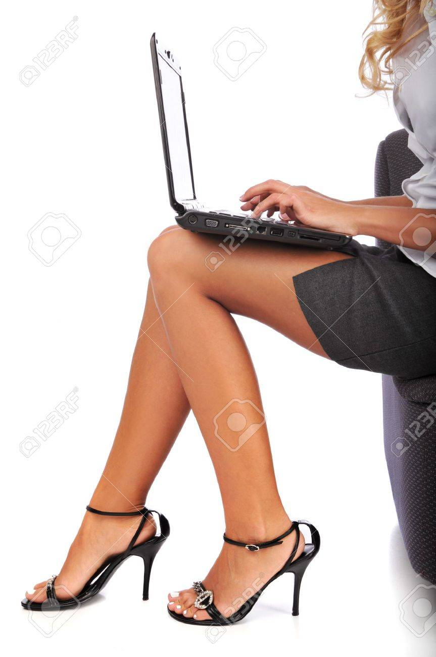 Businesswoman using a laptop isolated against a white background Stock Photo - 7961656