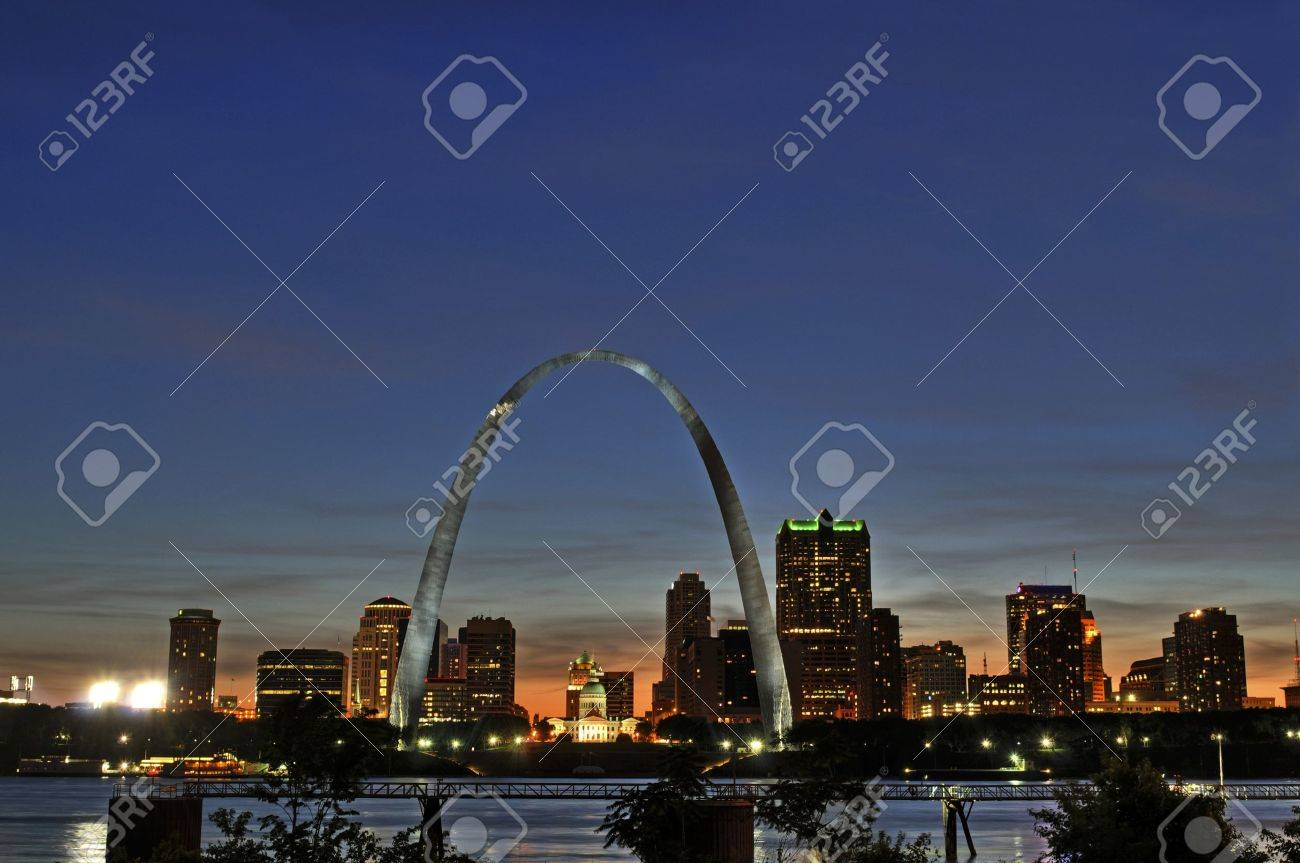 Saint Louis Skyline with the Mississippi river in front after sunset Stock Photo - 7968347