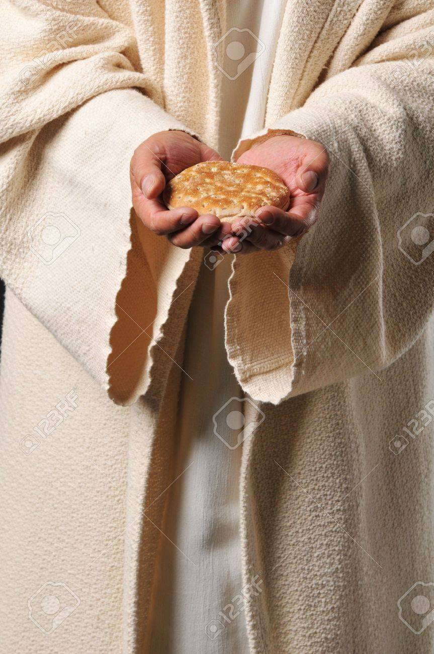 Jesus holding a bread as a symbol of bread of life Stock Photo - 8037892