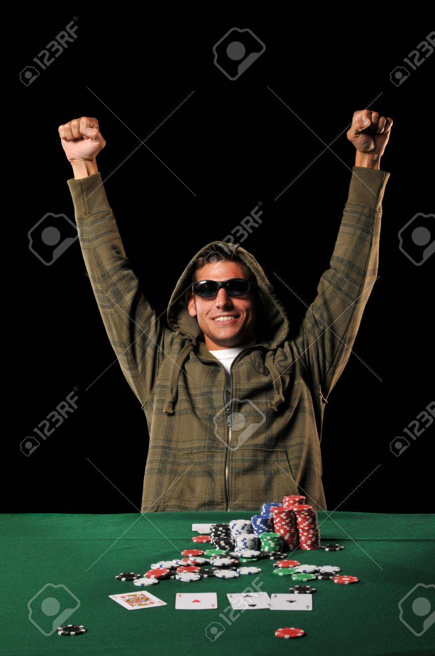 Poker player celebrating with extended arms isolated on a black background Stock Photo - 8166218