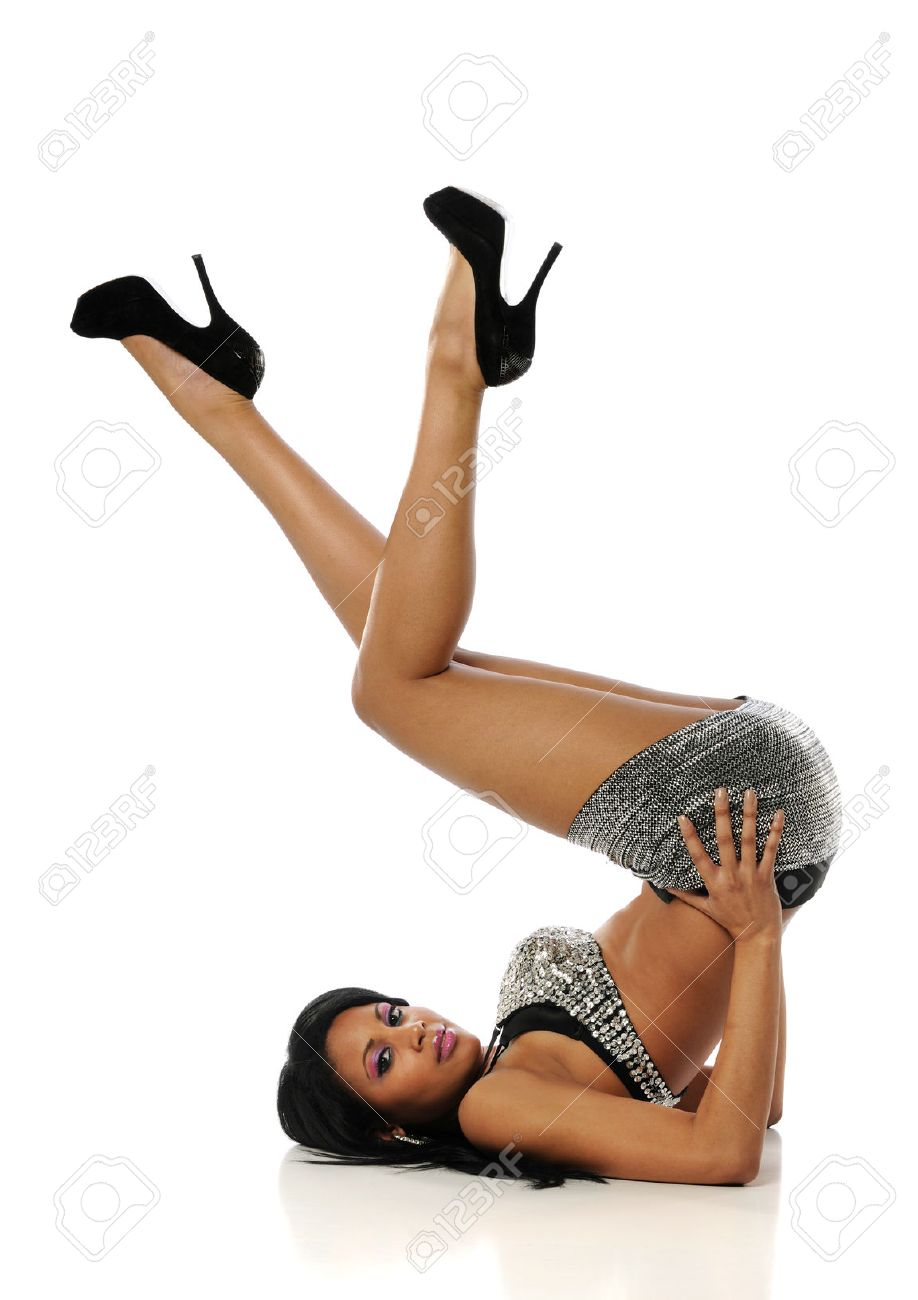 9ba1b92d326 Young African American woman wearing mini skirt and high heels..