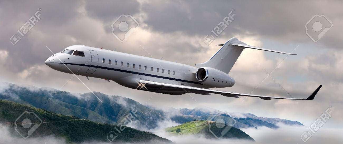Private jet flying over mountains - 47288894