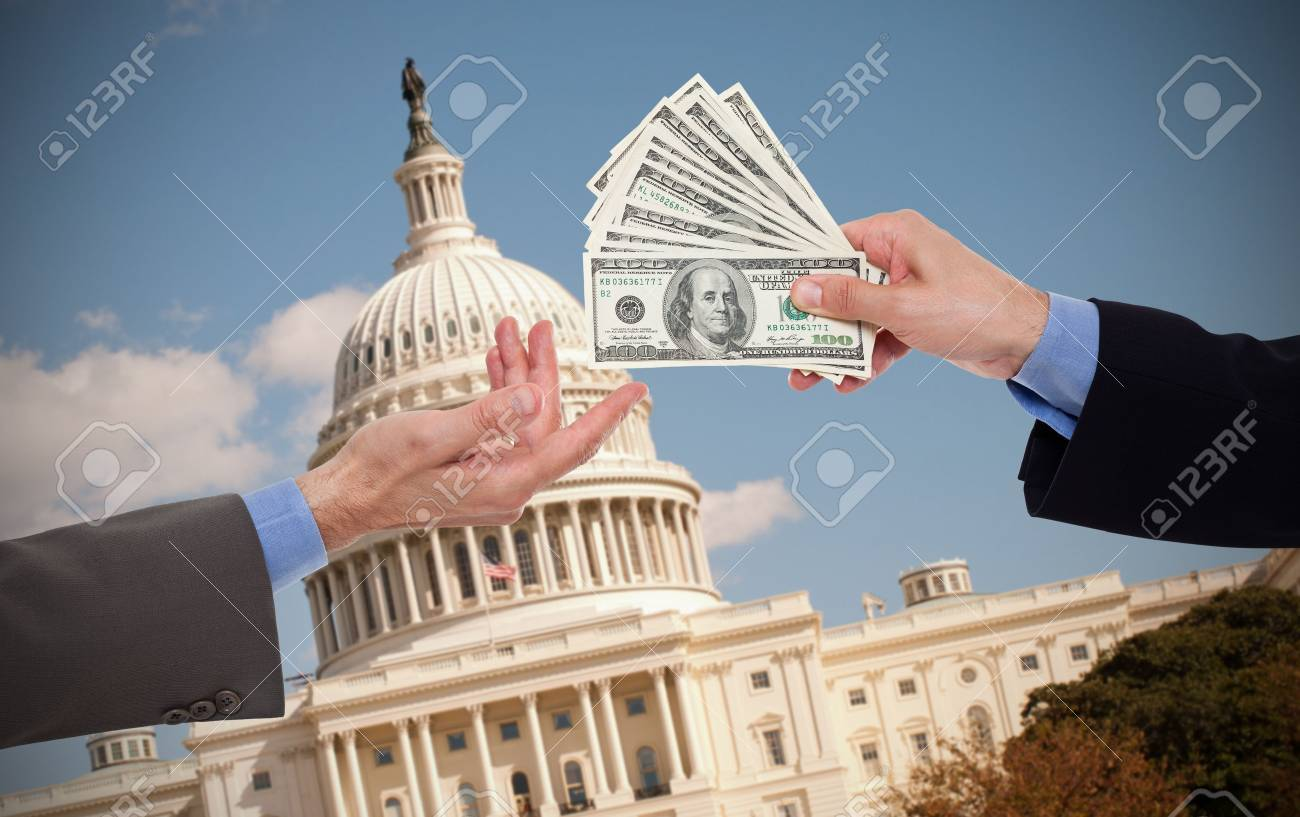 Giving a bribe, hands of businessmen or politicians - 47288952