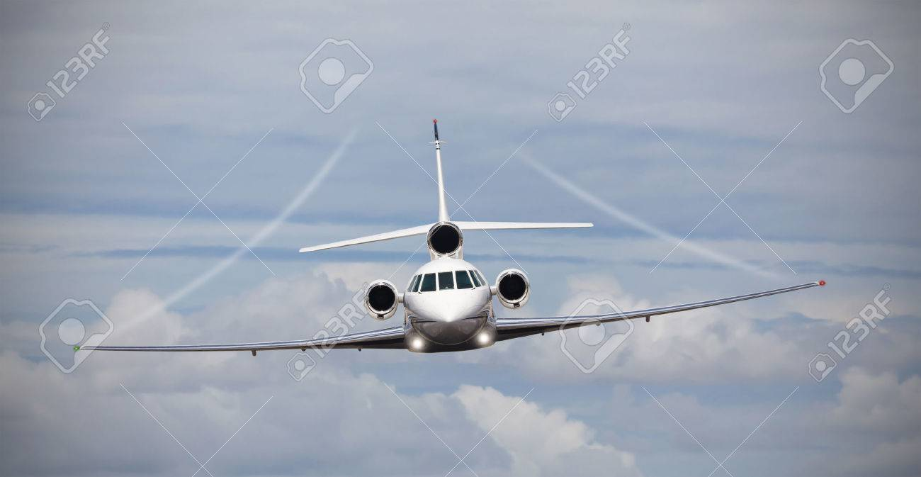Frontal view of a private jet in midair - 47289104
