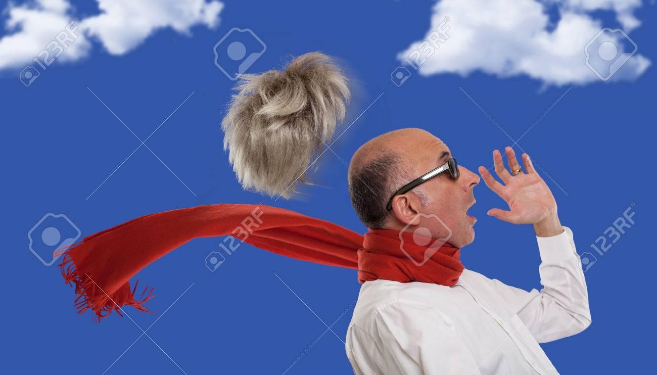 Man's toupee blown away by wind - 47767278