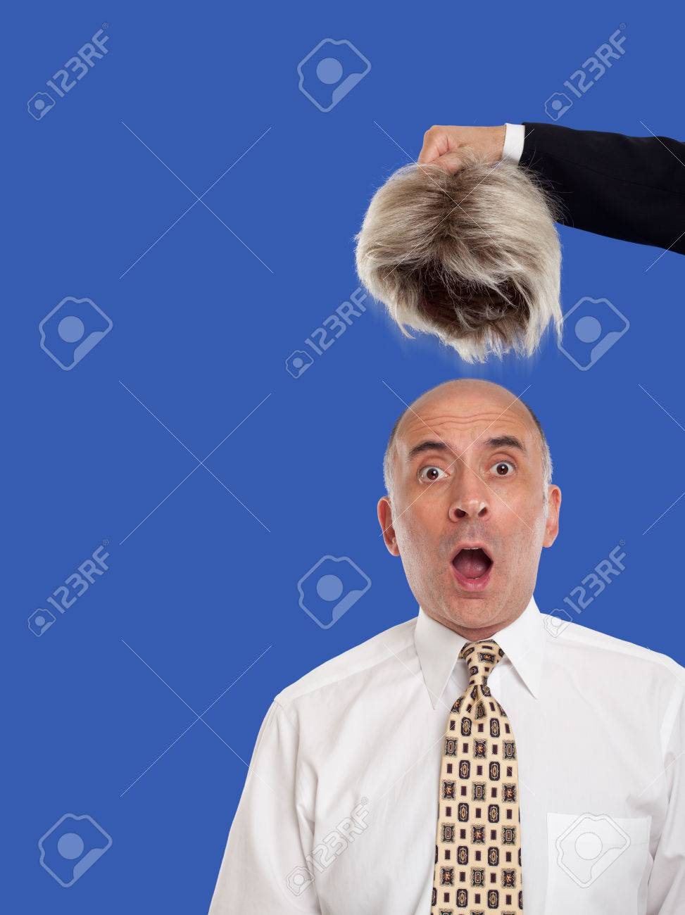 Bald man revealed by removing the toupee - 47767282
