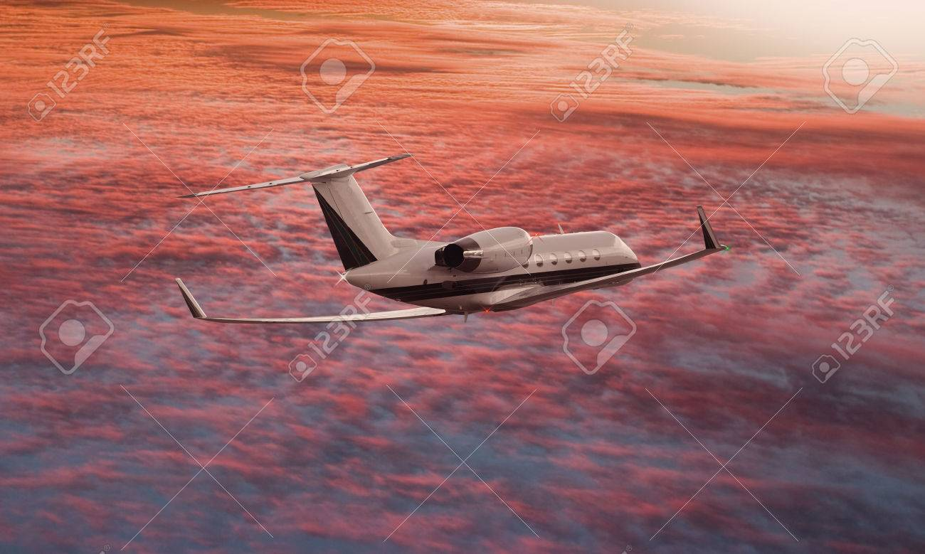 Private jet flying over a sunset sky - 48350523