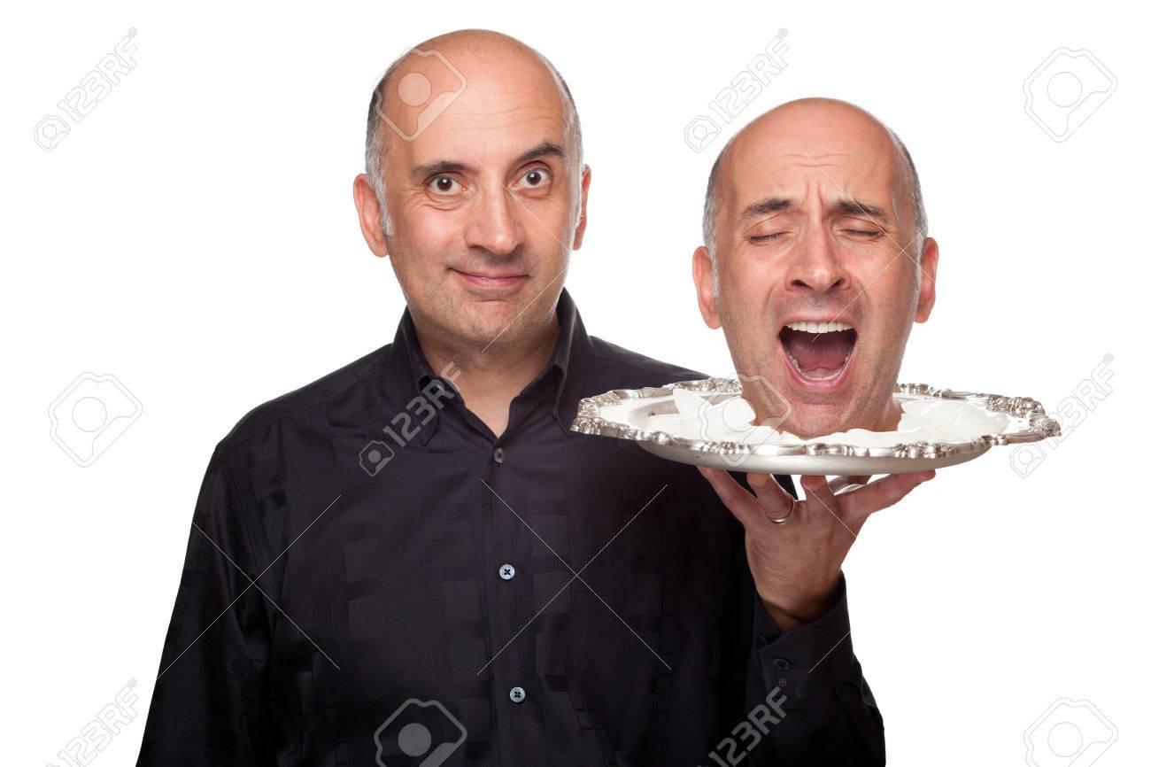 Man holding a head on a platter - 47691424