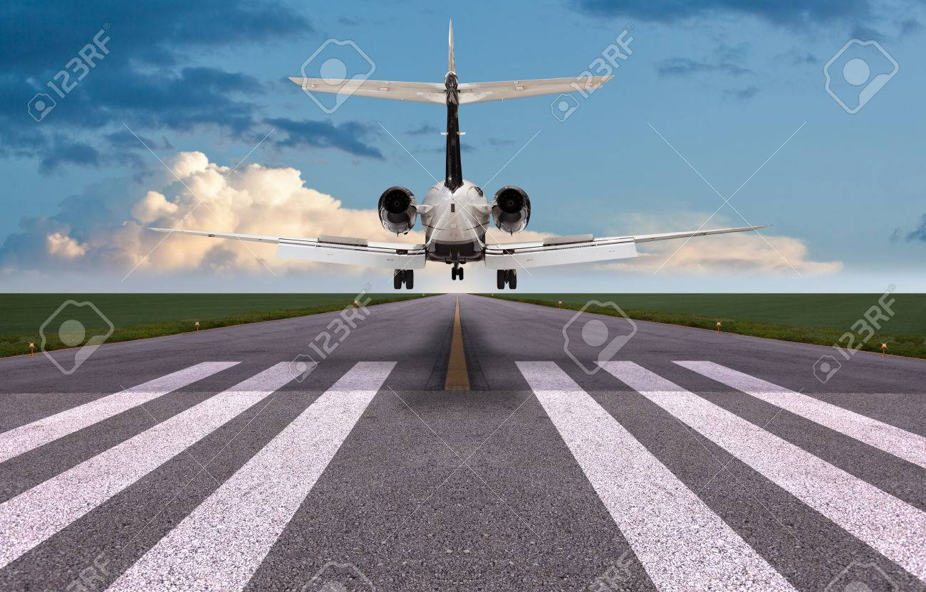 Rear view of a private jet landing - 57457411