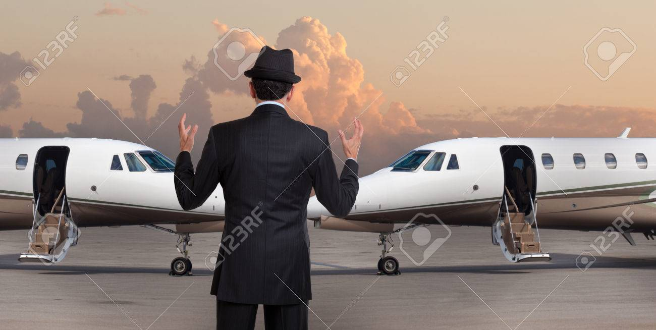 business man in front of two private jets stock photo picture and