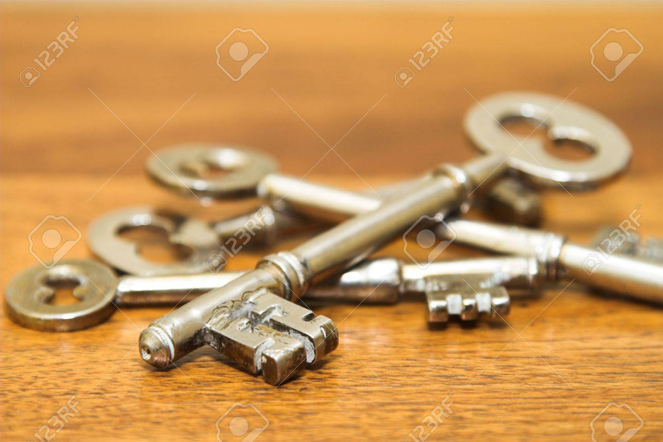 Antique door keys on a wooden surface Stock Photo - 2988186 - Antique Door Keys On A Wooden Surface Stock Photo, Picture And
