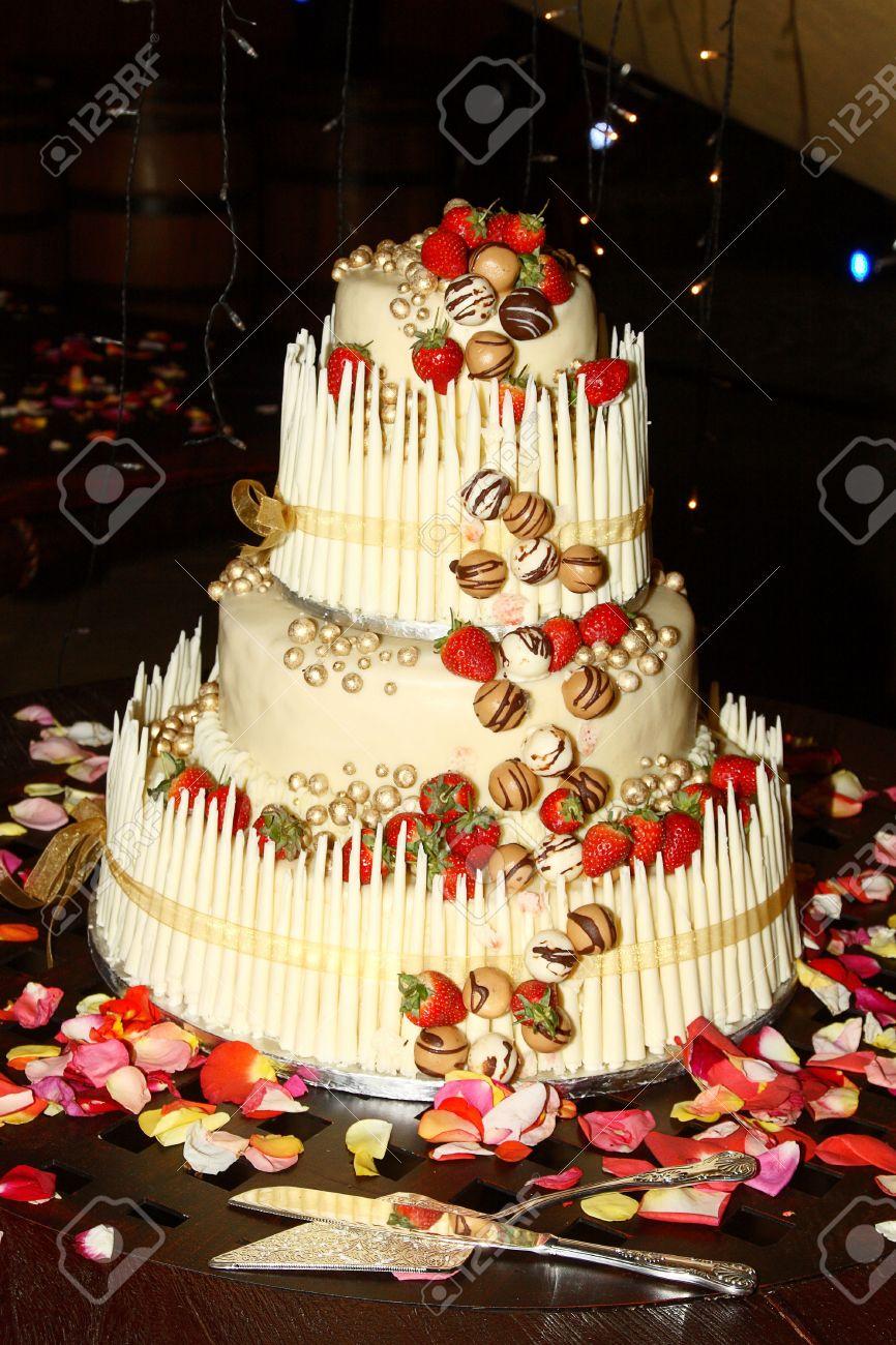 Strawberry And Chocolate Wedding Cake With Utensils Stock Photo ...