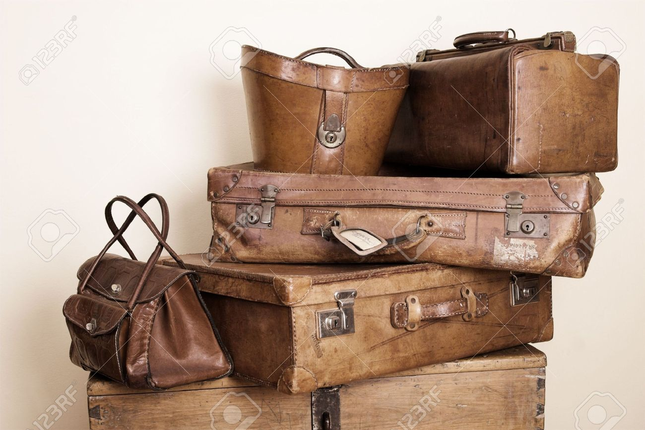 Collection Of Leather Suitcases And Bags Stacked Stock Photo ...