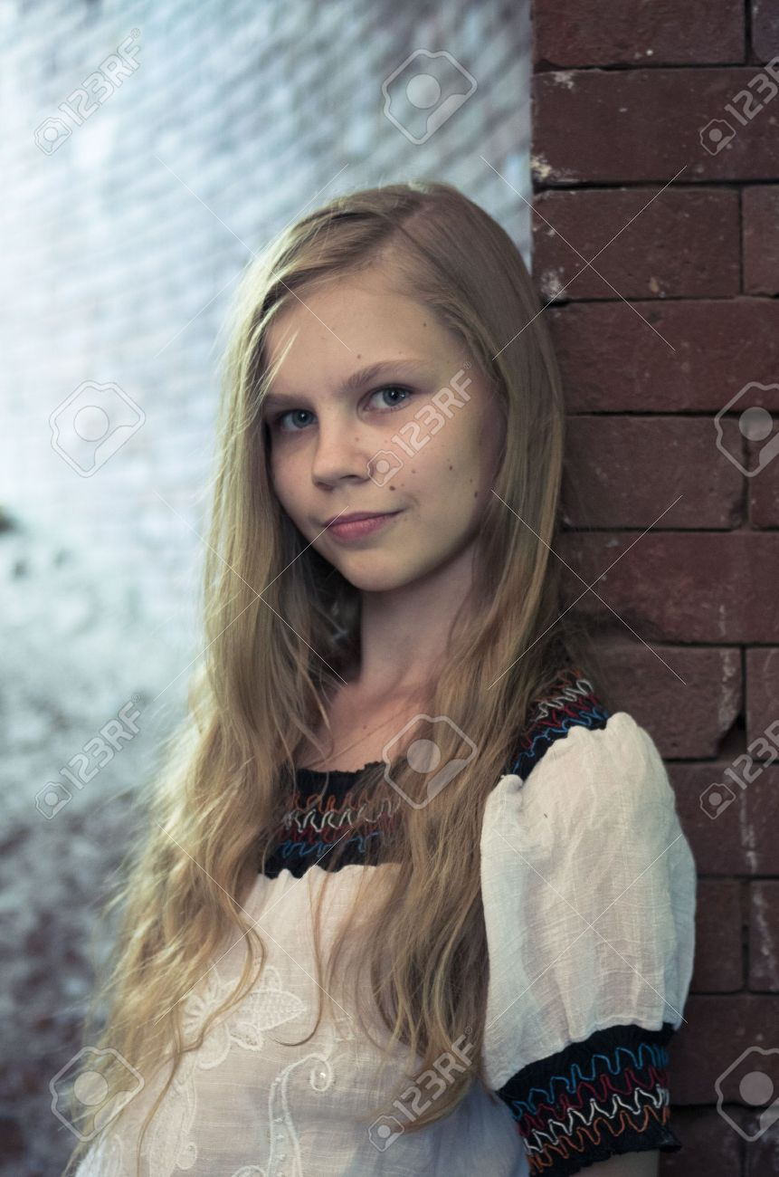 Portrait of teenage girl staying near brick wall in ruins Stock Photo - 14904236