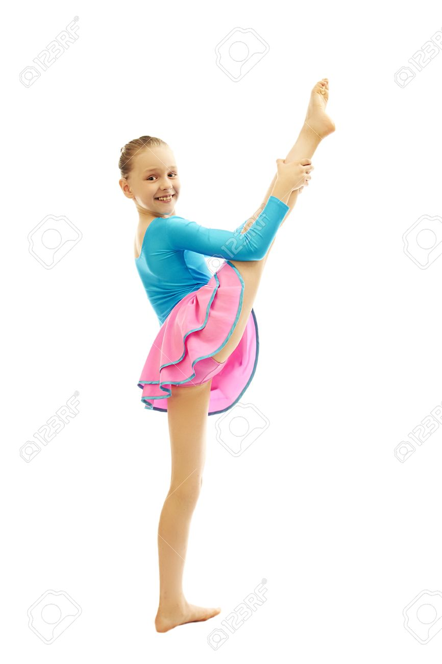 preteen stretch Stock Photo - young smiling preteen girl doing gymnastics stretching exercises on white background isolated
