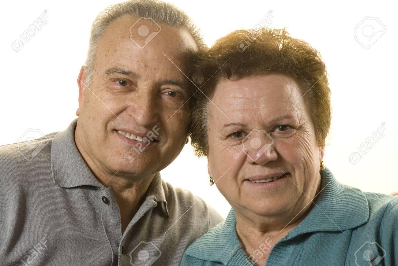 Lovely senior couple still in love on white background Stock Photo - 4695727