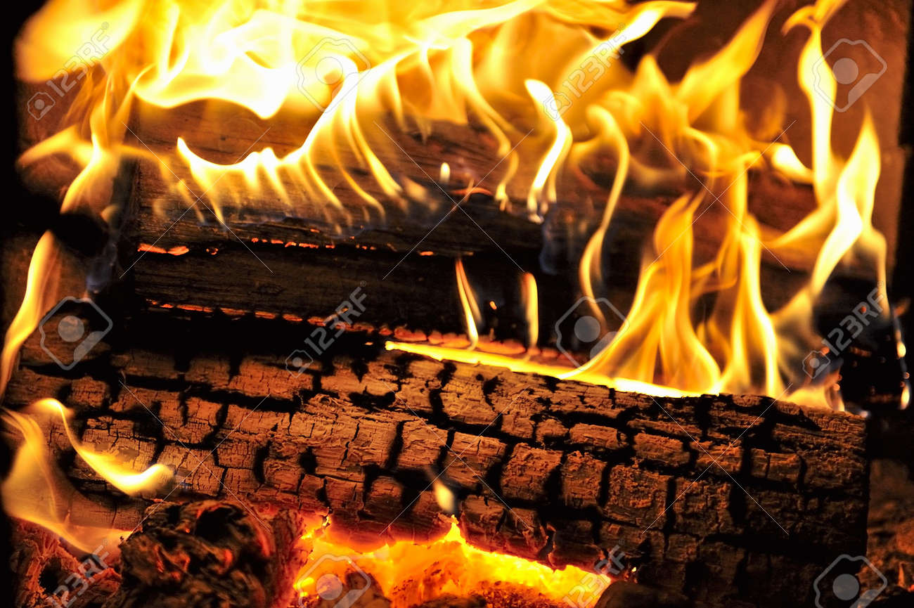 Dancing flames in a real woodburning fire in a woodburning stove. Stock Photo - 6002788