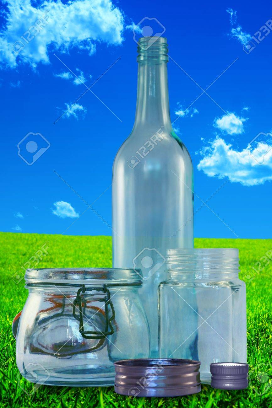 Three empty bottles without lids on on a vintage, grungy landscape background Stock Photo - 17106128