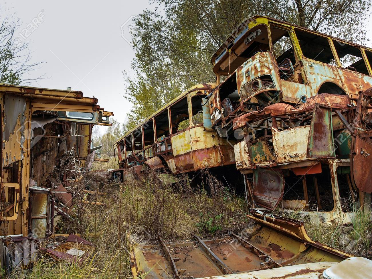 Scrap Yard In The Chernobyl Exclusion Zone With Old Military.. Stock ...