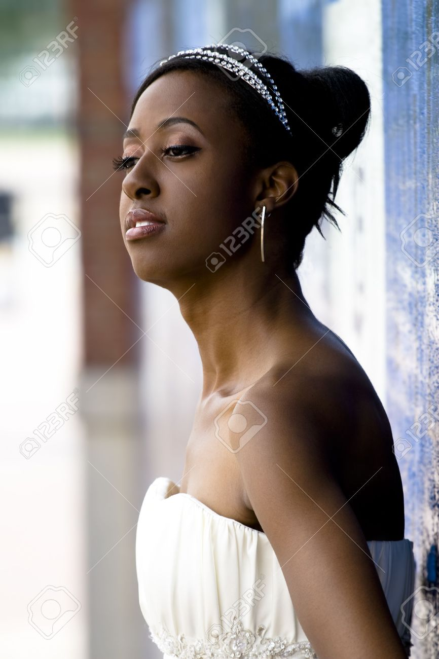 African American Model Wearing Wedding Gown Posed Against Colorful ...