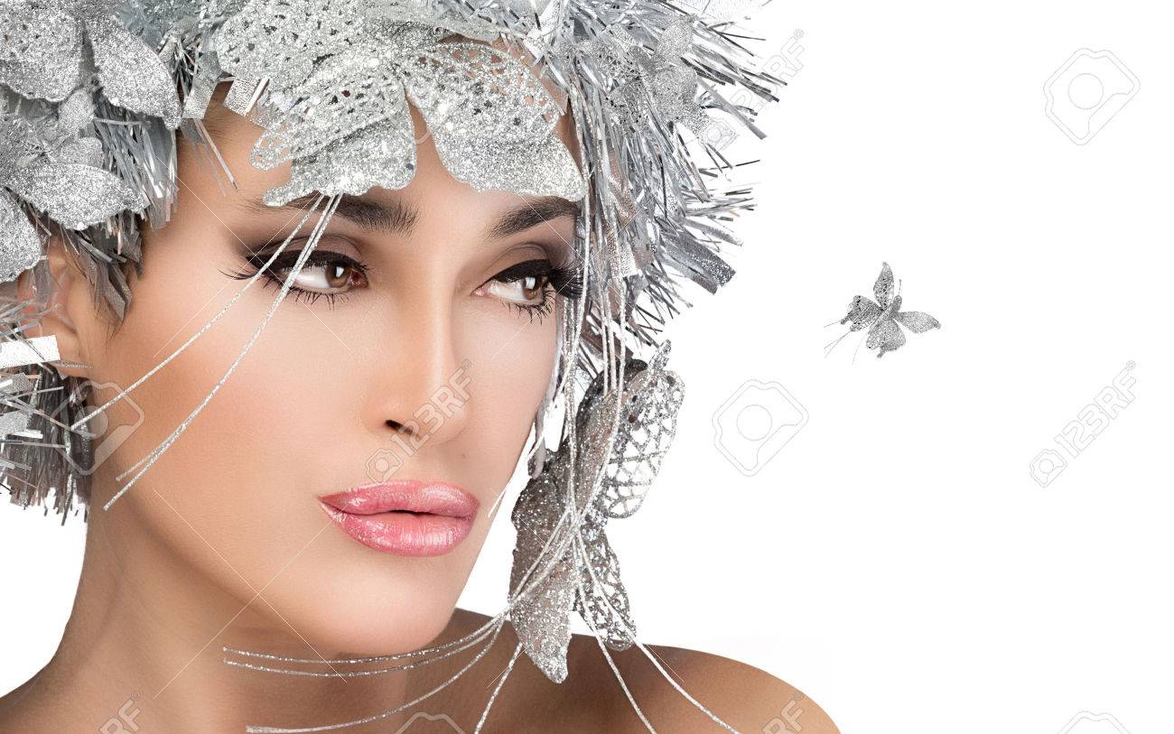 Beauty christmas girl with sensual lips. Holiday makeup and hairstyle Stock Photo - 24265540
