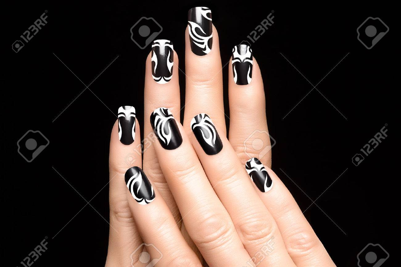 Closeup of woman hands with art nail design. Fashion print nail stickers.  Manicure and - Closeup Of Woman Hands With Art Nail Design. Fashion Print Nail