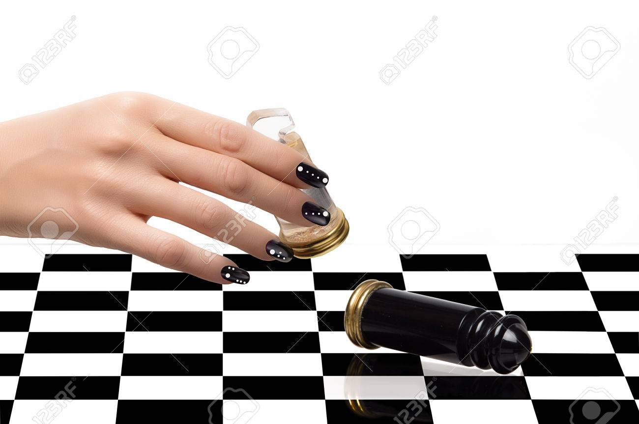 Beautiful Woman Hand With Luxury Nails In Black And White Playing ...