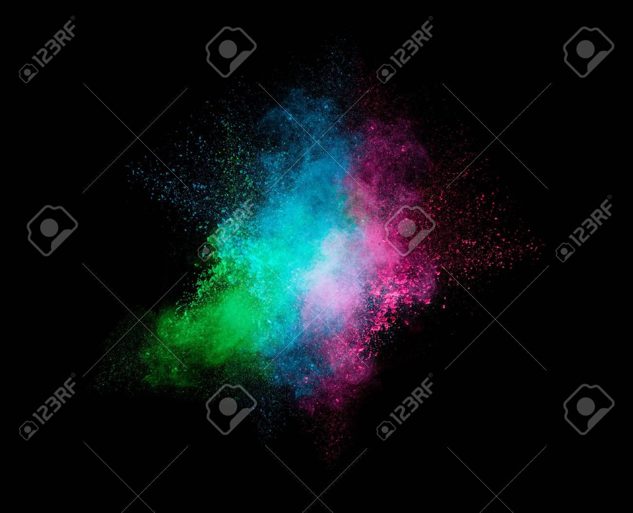 Colorful dust particle explosion resembling a pyrotechnic effect over black background. Closeup of a color explosion isolated on black - 55147186