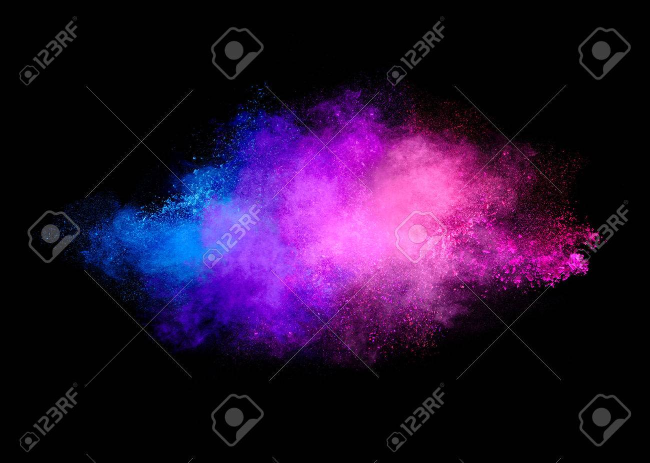 Colorful dust particle explosion resembling a pyrotechnic effect. Closeup of a color explosion isolated on black - 55314672